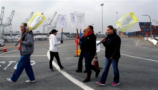 Clerical workers carry signs in protest at the Port of Long Beach, Calif. on Tuesday, December 4, 2012. (AP Photo/Nick Ut)