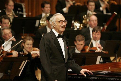FILE - This Dec. 6, 2005 file photo shows jazz pianist Dave Brubeck at his piano as he celebrates his 85th birthday on stage at London's Barbican Hall after a performance with the London Symphony Orchestra. (AP Photo/Alastair Grant, file)