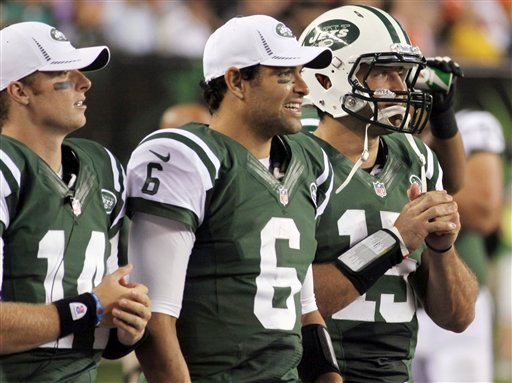 FILE - In this Aug. 10, 2012, file photo, New York Jets quarterbacks, from left, Greg McElroy, Mark Sanchez and Tim Tebow watch from the sidelines during the first half of a preseason NFL football game against the Cincinnati Bengals in Cincinnati. (AP Ph