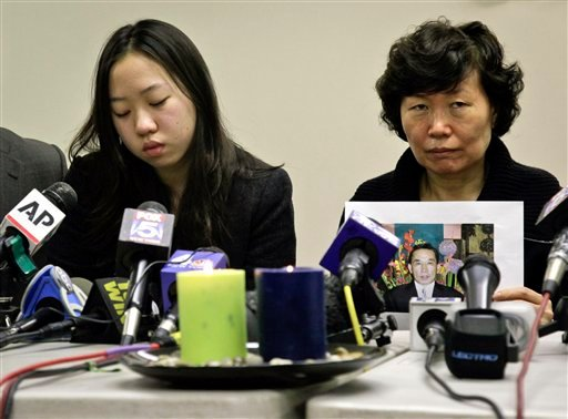 Serim Han , right, holds a picture of her husband Ki-Suck Han as she sits next to their daughter Ashley Han, 20, during a news conference on Wednesday, Dec. 5, 2012 in New York.  (AP Photo/Bebeto Matthews)