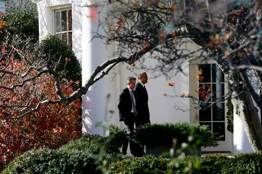 President Barack Obama walks with Treasury Secretary Timothy Geithner to the Oval Office at the White House in Washington, Wednesday, Dec. 5, 2012. (AP Photo/Charles Dharapak)