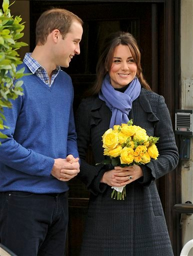 Britain's Prince William stands next to his wife Kate, Duchess of Cambridge as she leaves the King Edward VII hospital in central London, Thursday, Dec. 6, 2012. (AP Photo/Andrew Matthews, PA)