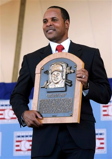 July 22, 2012 file photo: former Cincinnati Reds star Barry Larkin holds his plaque after his induction into the National Baseball Hall of Fame and Museum during a ceremony in Cooperstown, N.Y. (AP Photo/Tim Roske, FIle)