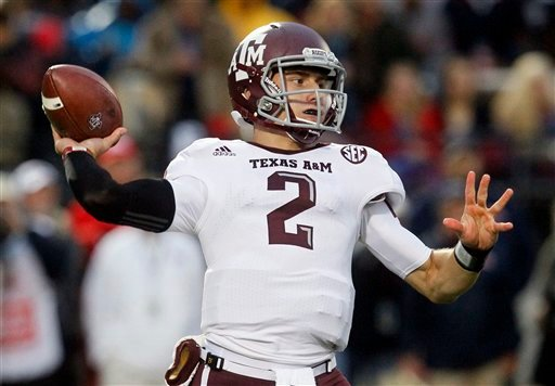 In this Oct. 6, 2012, file photo, Texas A&amp;M quarterback Johnny Manziel throws a short pass in the first quarter of an NCAA college football game against Mississippi in Oxford, Miss.