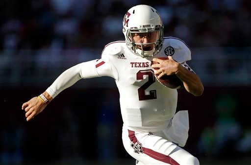 In this Nov. 10, 2012, file photo, Texas A&amp;M quarterback Johnny Manziel (2) runs for a first down during the first half of an NCAA college football game against Alabama at Bryant-Denny Stadium in Tuscaloosa, Ala.
