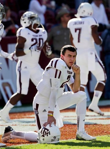 In this Nov. 10, 2012, file photo, Texas A&amp;M quarterback Johnny Manziel (2) watches the action prior to the start of an NCAA college football game against top-ranked Alabama at Bryant-Denny Stadium in Tuscaloosa, Ala.
