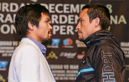 Manny Pacquiao, left, and Juan Manuel Marquez pose for photos during a news conference, Wednesday, Dec. 5, 2012, in Las Vegas. Pacquiao and Marquez are scheduled to face off in a welterweight boxing match on Saturday.