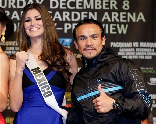 Juan Manuel Marquez, right, poses for photos with Miss Mexico Karina Gonzalez during a news conference, Wednesday, Dec. 5, 2012, in Las Vegas.