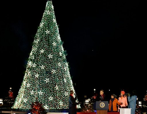 President Barack Obama, first lady Michelle Obama, Malia Obama, Sasha Obama and Michelle Obama's mother Marian Robinson, participate in the 90th annual National Christmas Tree Lighting ceremony on the Ellipse south of the White House. (AP Photo)