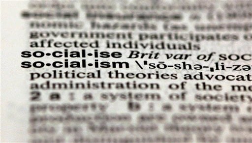 The word socialism, from the 11th edition of Merriam-Webster's Collegiate Dictionary, is shown in this photograph, in New York, Wednesday, Dec. 5, 2012. (AP Photo/Richard Drew)