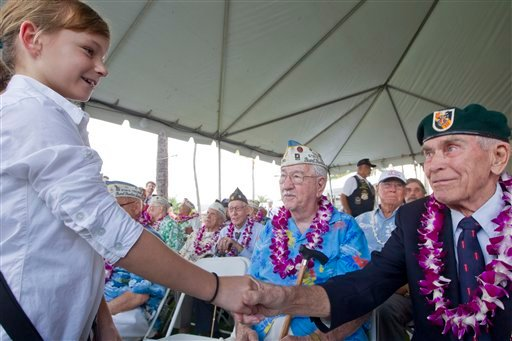 © Gabi Shultz, 10, resident of Joint Base Pearl Harbor Hickam, meets Pearl Harbor survivor Sam Clower, center, of Sacramento, Calif. and Ab Brum, right, retired United States Army Special Forces, of Kaneohe, Hawaii, Friday, Dec. 7, 2012, at Pearl Harbor.