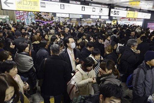 © People crowd at Sendai railway station in Sendai, Miyagi Prefecture, Friday, Dec. 7, 2012 after trains were halted following a strong earthquake struck off the coast of northeastern Japan.