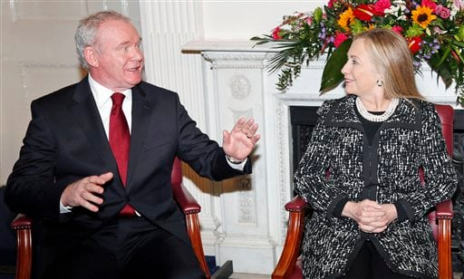 © U.S. Secretary of State Hillary Rodham Clinton, meets with Northern Ireland's Deputy First Minister Martin McGuinness, left, at Stormont Castle in Belfast, Northern Ireland, Friday, Dec. 7, 2012.