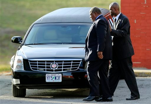  Kansas City Chiefs head coach Romeo Crennel, left, leaves a memorial service for Jovan Belcher at the Landmark International Deliverance and Worship Center, Wednesday, Dec. 5, 2012, in Kansas City, Mo.