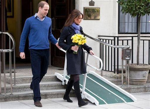 © In this Thursday, Dec. 6, 2012 file photo, Britain's Prince William stand next to his wife Kate, Duchess of Cambridge as she leaves the King Edward VII hospital in central London.