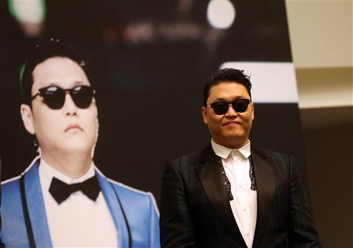 "FILE - In this Dec. 1, 2012 file photo, South Korean rapper PSY, who gained popularity from his famous song ""Gangnam Style,"" gives a press conference prior to his concert at the Marina Bay Sands in Singapore. (AP Photo/Wong Maye-E, File)"