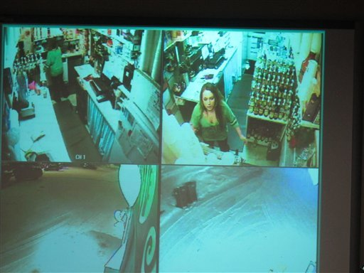 © During a news conference, police show surveillance video of Samantha Koenig, 18, making a cup of Americano coffee for a customer who shortly after abducted her Feb. 1, 2012, in Anchorage, Alaska.