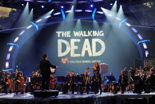 © An orchestra performs the musical themes for game of the year nominees on stage at Spike's 10th Annual Video Game Awards at Sony Studios on Friday, Dec. 7, 2012, in Culver City, Calif.