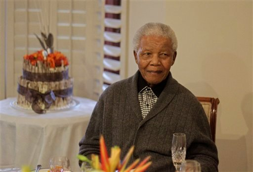 © In this Wednesday, July 18, 2012 file photo, former South African President Nelson Mandela as he celebrates his birthday with family in Qunu, South Africa.