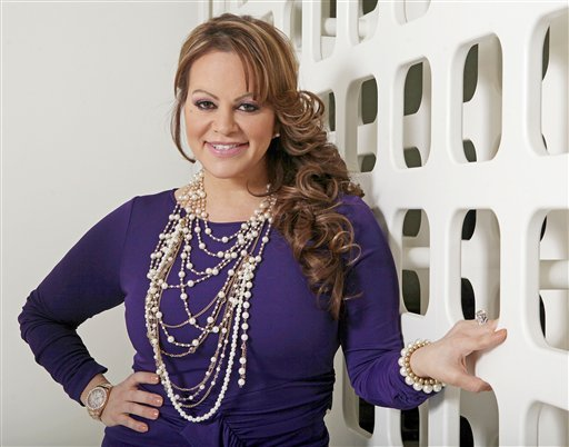 © In this March 8, 2012, file photo, Mexican-American singer and reality TV star Jenni Rivera poses during an interview in Los Angeles. Mexican authorities confirmed that the plane in which Rivera was traveling disappeared early Sunday, Dec. 9, 2012.