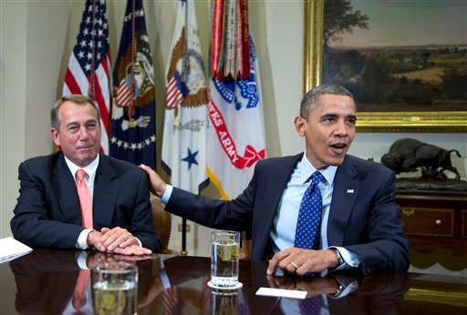 © In this Nov. 16, 2012, file photo, President Barack Obama acknowledges House Speaker John Boehner of Ohio while speaking to reporters in the Roosevelt Room of the White House in Washington, as he hosted a meeting of the bipartisan, bicameral leadership.