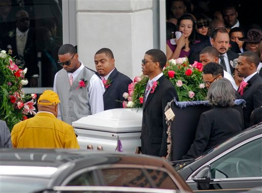 © Pallbearers carry the casket of Kasandra Perkins following her funeral service at the St. James Missionary Baptist Church on Saturday, Dec. 8, 2012, in Austin, Texas.