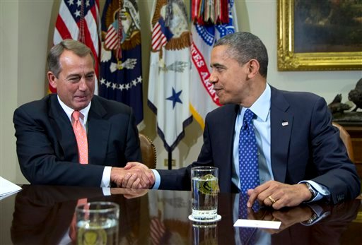 FILE - This Nov. 16, 2012 file photo shows President Barack Obama shaking hands with House Speaker John Boehner of Ohio in the Roosevelt Room of the White House in Washington, during a meeting to discuss the deficit and economy. (AP Photo/Carolyn Kaster)