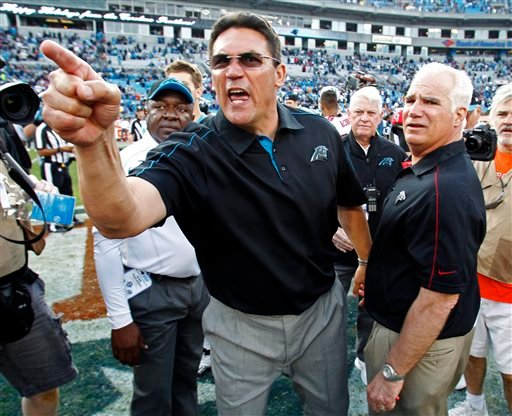  Carolina Panthers head coach Ron Rivera, left, shouts at players as Atlanta Falcons head coach Mike Smith, right, watches after an NFL football game in Charlotte, N.C., Sunday, Dec. 9, 2012.