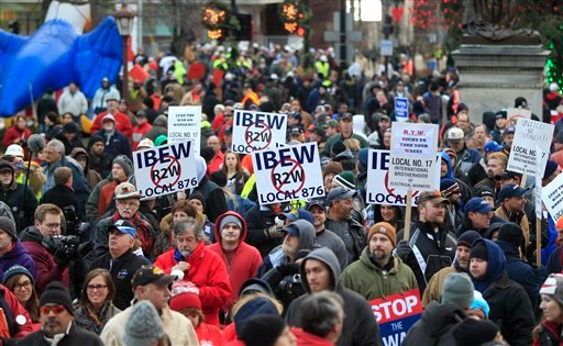 © Thousands of protesters gather for a rally on the State Capitol grounds in Lansing, Mich., Tuesday, Dec. 11, 2012.