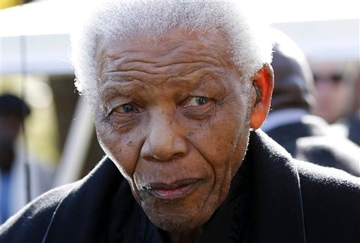 © In this June 17, 2010 file photo, former South African President, Nelson Mandela leaves the chapel after attending the funeral of his great-granddaughter Zenani Mandela in Johannesburg, South Africa.