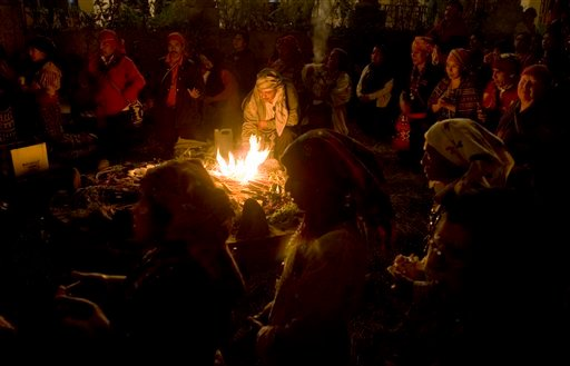 In this Feb. 21, 2011 file photo, Mayan priests pray during a ceremony marking the Mayan solar new year in Guatemala City.