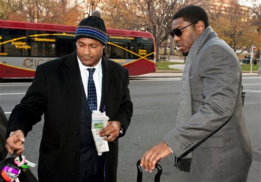 FILE - In this Nov. 30, 2012, file photo, New Orleans Saints football defensive end Will Smith, left, and linebacker Jonathan Vilma arrive at an attorney's office in Washington, for a hearing on their appeals of bounties suspensions. (AP Photo/Cliff Owen)