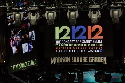 "Signage for the ""12-12-12"" concert is displayed on the Madison Square Garden jumbotron, Tuesday, Dec. 11, 2012, in New York. (AP Photo/John Minchillo)"