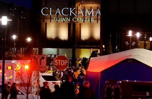 Police and medics work the scene of a multiple shooting at Clackamas Town Center Mall in Clackamas, Ore., Tuesday Dec. 11, 2012. (AP Photo/Greg Wahl-Stephens)