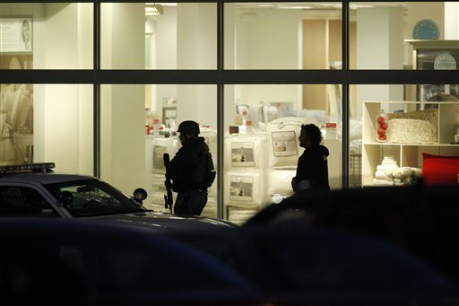 Law enforcement personnel work the scene of a shooting at the Clackamas Town Center in Portland, Ore. Tuesday, Dec. 11, 2012. (AP Photo/The Oregonian, Bruce Ely)