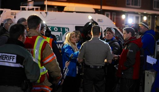 Media gather around Clackamas County sheriff's Lt. James Rhodes during a news conference at the scene of a multiple shooting at Clackamas Town Center Mall in Clackamas, Ore., Tuesday Dec. 11, 2012. (AP Photo/Greg Wahl-Stephens)