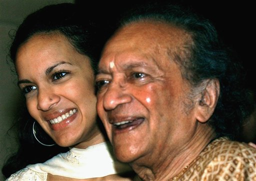 In this Dec. 19, 2002, Indian Sitar maestro Ravi Shankar, right, and daughter Anoushka Shankar smile during a press conference in Calcutta, India. (AP Photo/Bikas Das, File)