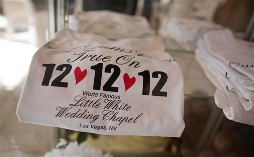 Tee shirts advertising the 12-12-12 date sit on display at A Little White Wedding Chapel, Tuesday, Dec. 11, 2012, in Las Vegas. (AP Photo/Julie Jacobson)