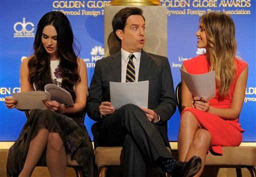 Presenters Ed Helms and Jessica Alba, right, mingle as fellow presenter Megan Fox studies her script before the announcement of nominations for the 70th Annual Golden Globe Awards Dec. 13, 2012, in Beverly Hills. (Photo by Chris Pizzello/Invision/AP)