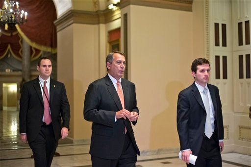 Speaker of the House John Boehner, R-Ohio, walks to the House floor during a vote at the Capitol in Washington, Wednesday evening, Dec. 12, 2012. (AP Photo/J. Scott Applewhite)