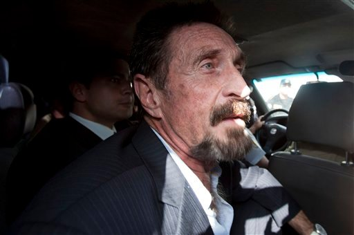 Software company founder John McAfee leaves an immigration detention center for the La Aurora international airport in Guatemala City, Wednesday Dec. 12, 2012. (AP Photo/Moises Castillo)