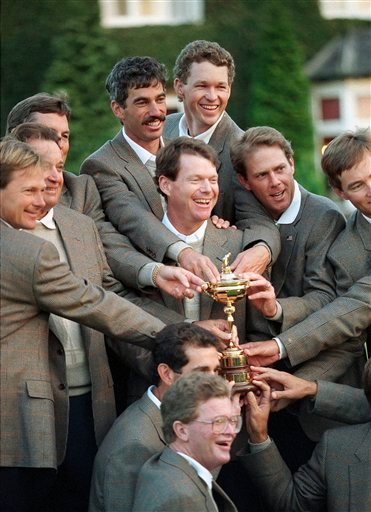 This Sept. 26, 1993, file photo shows American Ryder Cup captain Tom Watson, center, posing with his winning team after they were presented with the trophy at the Belfry Golf Club in Sutton Coldfield, England.