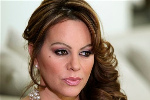 © In this March 8, 2012 file photo, Mexican-American singer and reality TV star Jenni Rivera poses during an interview in Los Angeles.