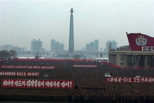 Slogans honoring the leadership and celebrating the successful rocket launch of a satellite are displayed during a mass rally on Kim Il Sung Square in Pyongyang, North Korea, Friday, Dec. 14, 2012.