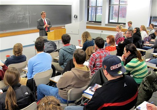 In this Nov. 27, 2012 photo Marquette University professor Tim Machan teaches a class on J.R.R. Tolkien that focuses on all of his books, books that influenced Tolkien and other tidbits about the writer.