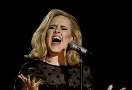© This Feb. 12, 2012 file photo shows Adele performing during the 54th annual Grammy Awards in Los Angeles. Adele has the year's top-selling album on iTunes.