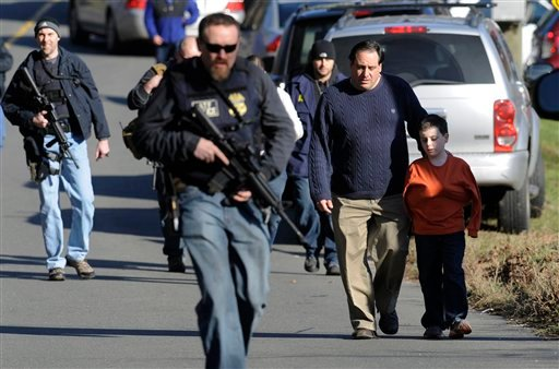 © Parents leave a staging area after being reunited with their children following a shooting at the Sandy Hook Elementary School in Newtown, Conn., about 60 miles (96 kilometers) northeast of New York City, Friday, Dec. 14, 2012. (AP Photo/Jessica Hill)