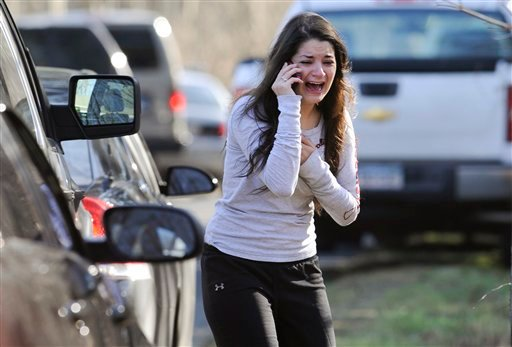 © A woman waits to hear about her sister, a teacher, following a shooting at the Sandy Hook Elementary School in Newtown, Conn. where authorities say a gunman opened fire, leaving 27 people dead, including 20 children, Friday, Dec. 14, 2012.
