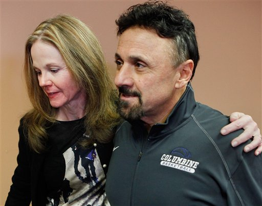 Frank DíAngelis, right, Columbine High School Principal at time of the 1999 school massacre and still principal today is comforted by long time friend Cindy Stevenson, Superintendent of JEFCO Schools after a news conference. (AP Photo/Ed Andrieski)