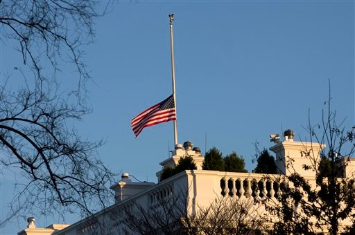© An American flag flies at half-staff over the White House in Washington, Friday, Dec. 14, 2012, in honor of the Connecticut elementary school shooting victims. (AP Photo/Charles Dharapak)